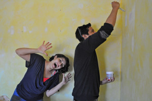 Volunteer Luar Cervantes helps our Mental Health Intake worker, Katherine Borja Fischer, paint her office.